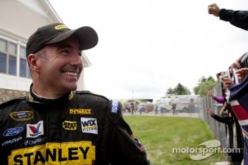 Race winner Marcos Ambrose, Petty Motorsport Ford celebrates