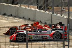 #12 Autocon Lola B06/10 AER: Tony Burgess, Chris McMurry and #89 Intersport Racing Oreca FLM09: Chapman Ducote, David Ducote in the escape road