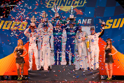 GT podium: class winners Wolf Henzler and Bryan Sellers, second place Dirk Müller and Joey Hand, third place Oliver Gavin and Jan Magnussen