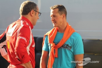 Stefano Domenicali Ferrari General Director and Michael Schumacher, Mercedes GP F1 Team
