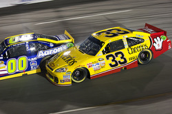 Clint Bowyer, Richard Childress Racing Chevrolet and David Reutimann, Michael Waltrip Racing Toyota spin out