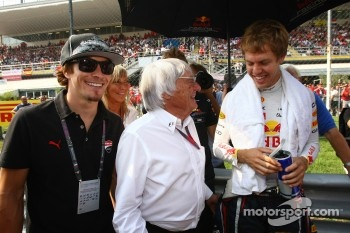 Nicky Hayden Motor GP rider and Bernie Ecclestone and Sebastian Vettel, Red Bull Racing