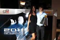 Esteban Gutierrez collects his Dallara trophy for best overtake