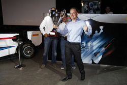 Valtteri Bottas, collects the GP3 champions trophy with Bruno Michel