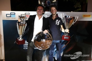 2011 GP2 Series Champion Romain Grosjean collects the GP2 Champion Trophy, with Alejandro Agag, Addax team principal