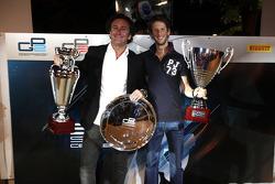 2011 GP2 Series Champion Romain Grosjean collects the GP2 Champion Trophy, with Alejandro Agag, Addax team principal