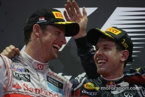 2011 Podium: race winner Sebastian Vettel, Red Bull Racing with Jenson Button, McLaren Mercedes
