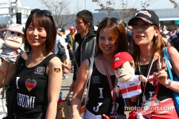 Fans of Michael Schumacher, Mercedes GP and Jenson Button, McLaren Mercedes