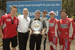 James Courtney of the Holden Racing Team, V8 Supercars Chairman Tony Cochrane, Phil Reeves, Queensland Minister for Child Safety and Sport, Vitantonio Liuzzi of Wilson Security Racing, Ryan Briscoe and Darren Turner of the Holden Racing Team Racing pose w