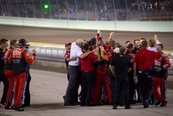 Stewart-Haas Racing Chevrolet team members celebrates as Tony Stewart wins the NASCAR Sprint Cup Series 2011 championship