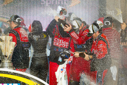 Victory lane: Stewart-Haas Racing team members celebrate with champagne