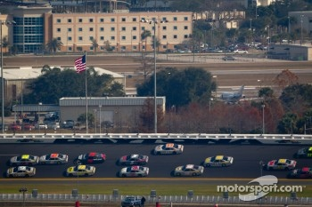 A.J. Allmendinger, Penske Racing Dodge and Marcos Ambrose, Petty Motorsport Ford lead the pack