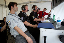 Lucas Luhr and Allan McNish look on as Ryan Dalziel sets the fastest lap