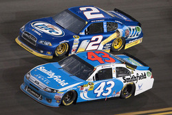 Aric Almirola, Richard Petty Motorsports Ford and Brad Keselowski, Penske Racing Dodge