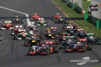 Jenson Button, McLaren Mercedes leads the start of the race