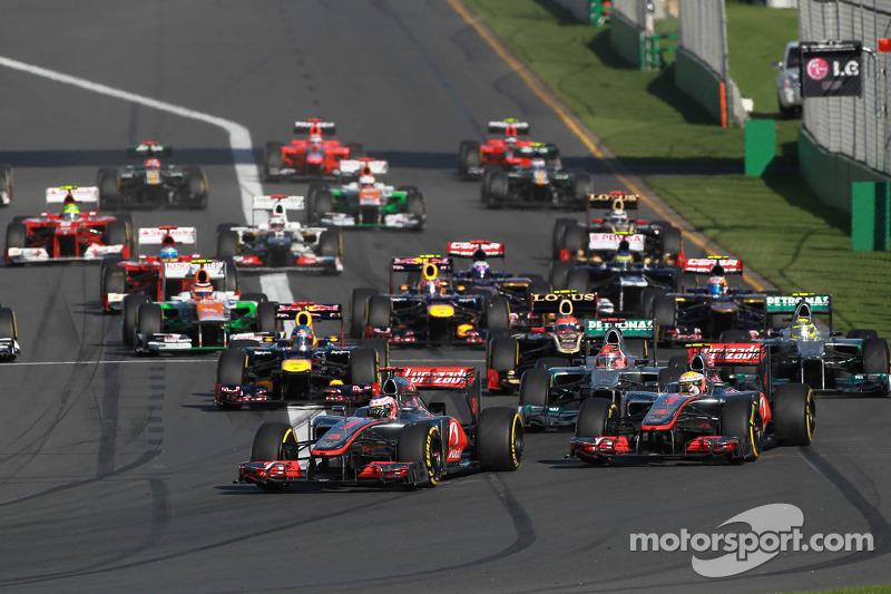 Jenson Button, McLaren Mercedes leads the start of the race
