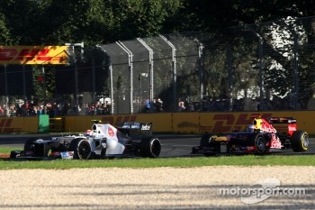 Sergio Perez, Sauber F1 Team and Sebastian Vettel, Red Bull Racing