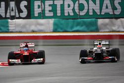 Fernando Alonso, Scuderia Ferrari and Sergio Perez, Sauber F1 Team