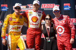 Podium: race winner Helio Castroneves, Team Penske Chevrolet, second place Scott Dixon, Target Chip Ganassi Racing Honda, third place Ryan Hunter-Reay, Andretti Autosport Chevrolet with Holly Wheldon, sister of the late Dan Wheldon