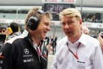 Dr. Aki Hintsa, McLaren Team Doctor with Mika Hakkinen