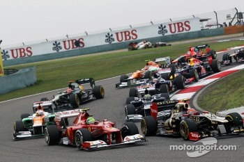 Felipe Massa, Ferrari and Romain Grosjean, Lotus F1 battle at the start of the race