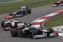 Bruno Senna, Williams F1 Team leads Lewis Hamilton, McLaren Mercedes