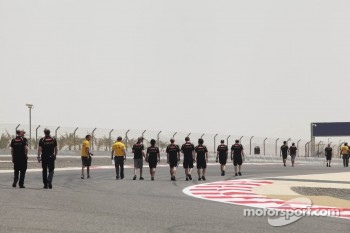 The Lotus F1 Team walk the circuit