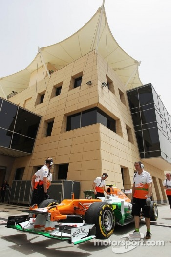 The Sahara Force India F1 of Nico Hulkenberg, at the pit lane entrance