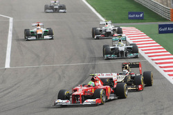 Felipe Massa, Ferrari leads Kimi Raikkonen, Lotus