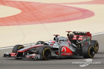 Jenson Button, McLaren and Kimi Raikkonen, Lotus