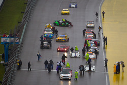 Cars head to the starting grid on track
