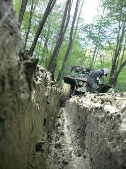Philon Parpottas struggling with the mud