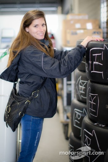 Cyndie Allemann checks tires