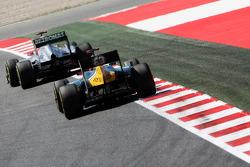 Michael Schumacher, Mercedes AMG F1 leads Heikki Kovalainen, Caterham