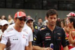 Jenson Button, McLaren with Mark Webber, Red Bull Racing on the drivers parade
