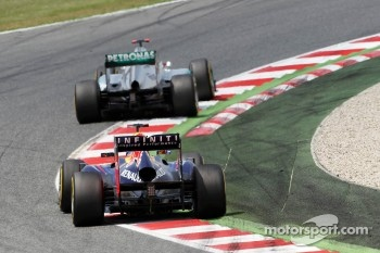 Michael Schumacher, Mercedes AMG F1 leads Sebastian Vettel, Red Bull Racing