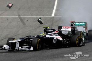 Michael Schumacher, Mercedes GP crashes with Bruno Senna, Williams F1 Team at turn 1