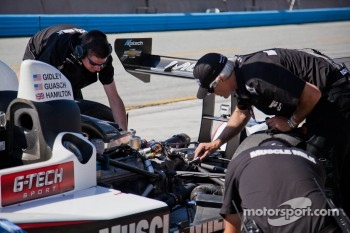 Muscle Milk Pickett Racing crew inspecting the engine