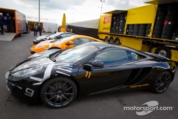 McLaren cars in the paddock