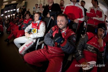 Audi Sport Team Phoenix team members watch the race