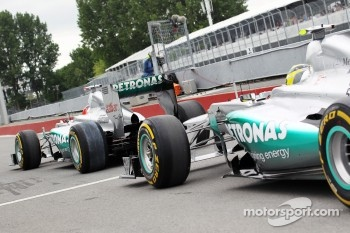 Michael Schumacher, Mercedes AMG F1 and team mate Nico Rosberg, Mercedes AMG F1 leave the pits