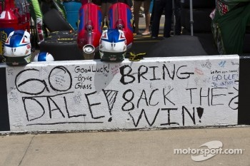 Fans sign the pit wall