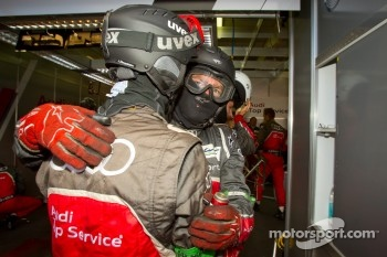 Audi Sport team members congratulate each other after repairing the #3 Audi Sport Team Joest Audi R18 Ultra
