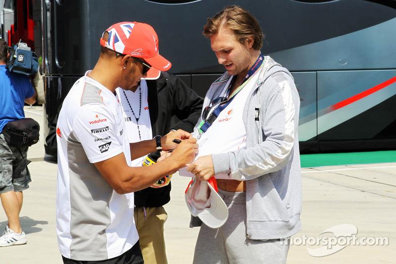 Lewis Hamilton, McLaren Mercedes Mercedes signs autographs for the fans
