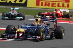 Mark Webber, Red Bull Racing leads Michael Schumacher, Mercedes AMG Petronas