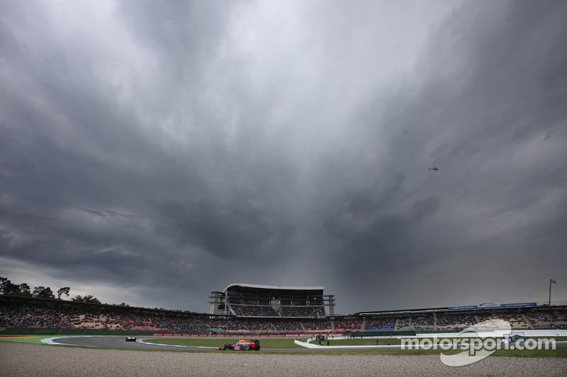 Sebastian Vettel, Red Bull Racing under dark clouds