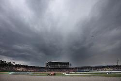 Sebastian Vettel, Red Bull Racing under dark clouds