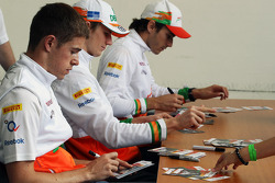 Paul di Resta, Sahara Force India F1; Nico Hulkenberg, Sahara Force India F1 and Jules Bianchi, Sahara Force India F1 Team Third Driver sign autographs for the fans
