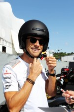 Jenson Button, McLaren arrives at the circuit on a motorbike