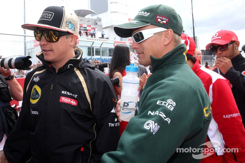 Kimi Raikkonen, Lotus F1 Team and Heikki Kovalainen, Caterham F1 Team
